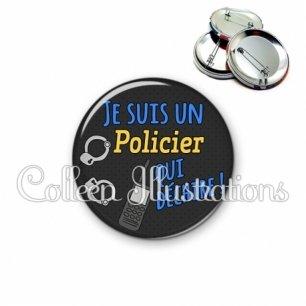 Badge 56mm Policier qui déchire (167GRI01)